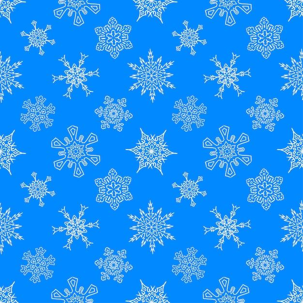 Patrón azul con copos de nieve dibujados Vector Premium