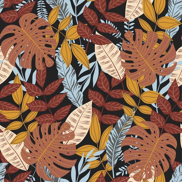 Patrón sin costuras de verano con coloridas plantas y hojas tropicales Vector Premium