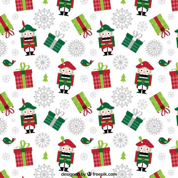 Patrón de navidad con regalos y cascanueces | Descargar Vectores gratis