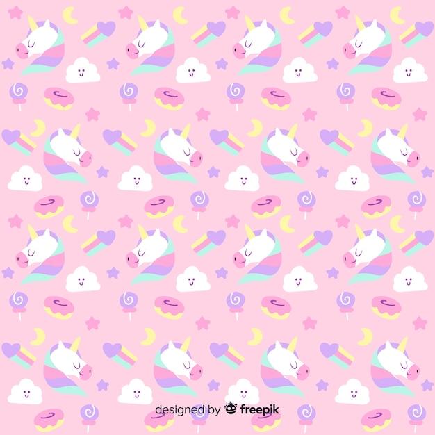 Patrón fantástico dibujado de unicornios vector gratuito