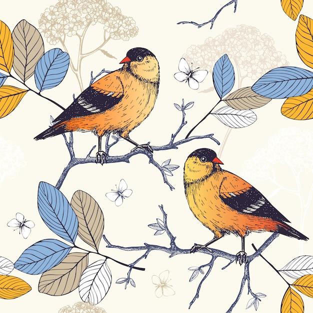 Patrón sin fisuras con tinta pájaros dibujados a mano en ramitas de árbol floreciente. fondo de dibujo vintage con pájaros naranjas Vector Premium