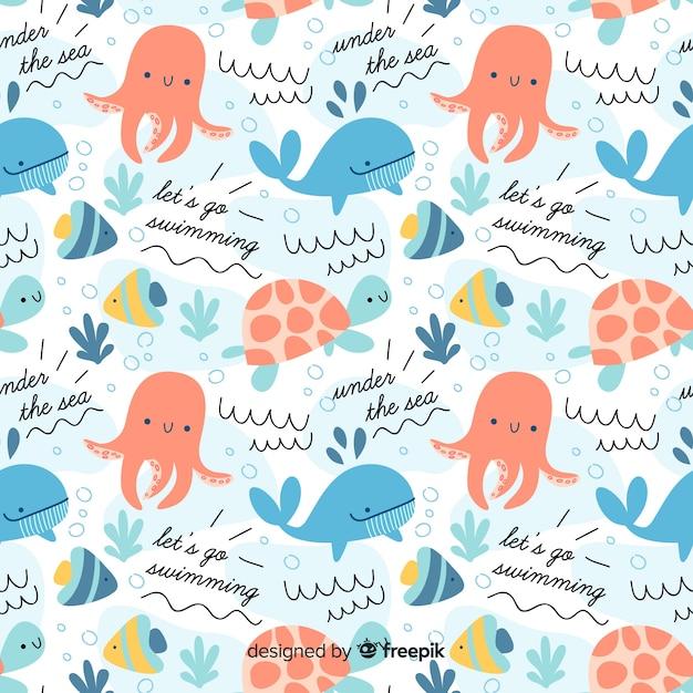 Patrón garabatos coloridos animales marinos y palabras Vector Premium