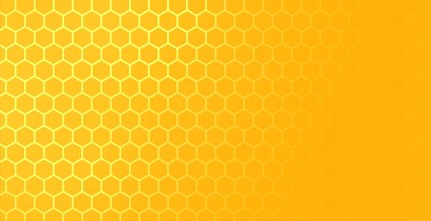 Patrón de malla de panal hexagonal amarillo con espacio de texto vector gratuito