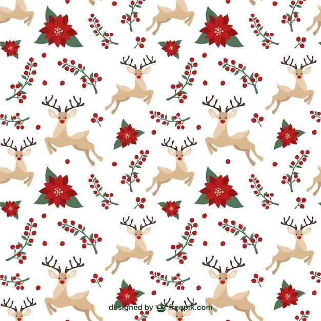Patrón de renos navideños y muérdago | Descargar Vectores Premium