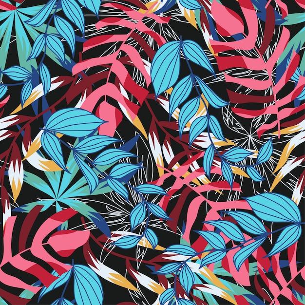 Patrón transparente abstracto brillante con coloridas hojas tropicales y plantas en la oscuridad Vector Premium
