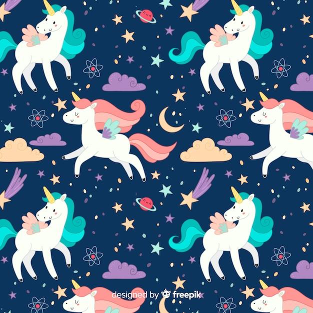 Patrón unicornio estilo dibujado a mano vector gratuito