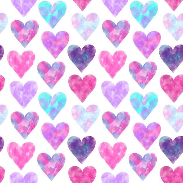 Patrones sin fisuras de corazones de acuarelas rosas y púrpuras Vector Premium