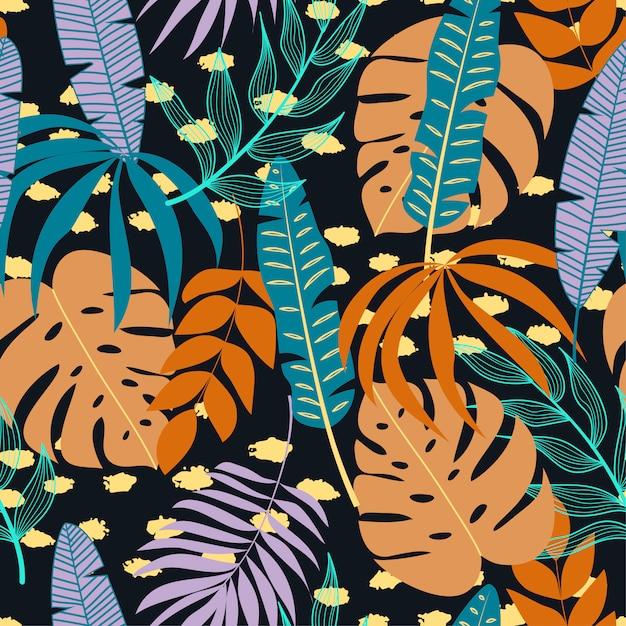 Patrones sin fisuras con plantas tropicales y hojas sobre fondo oscuro Vector Premium