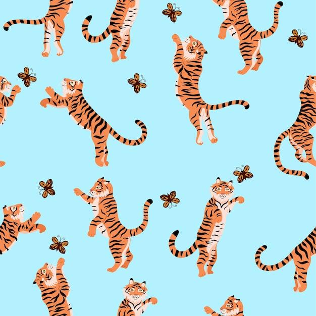 Patrones sin fisuras con tigres jugando con mariposas Vector Premium