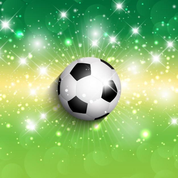 Pelota de f tbol en un fondo verde brillante descargar for Fondos de futbol