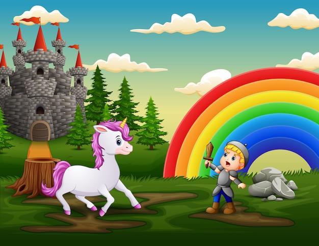 Pequeño caballero lucha contra un unicornio en el patio del castillo Vector Premium