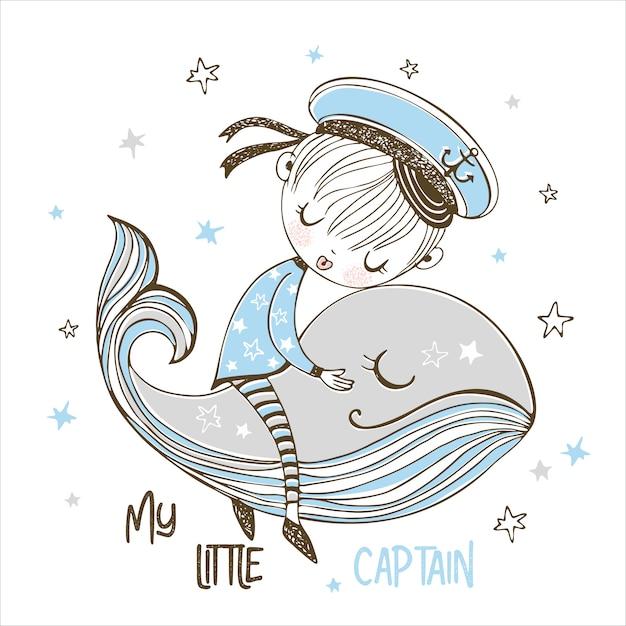 Un pequeño marinero duerme dulcemente en una ballena mágica. Vector Premium