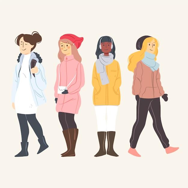 Las personas que usan ropa de invierno establecen ilustración vector gratuito
