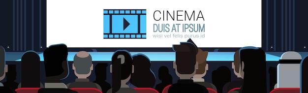 Personas sentadas en el cine mirando la pantalla vacía esperando película comenzar atrás vista posterior horizontal b Vector Premium