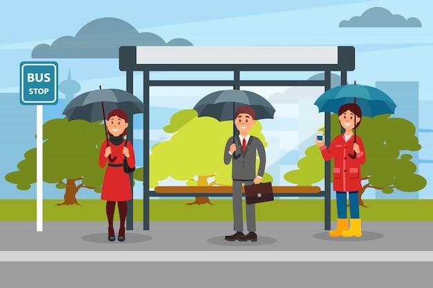 Las personas con sombrillas esperando el autobús en la parada de autobús ilustración Vector Premium