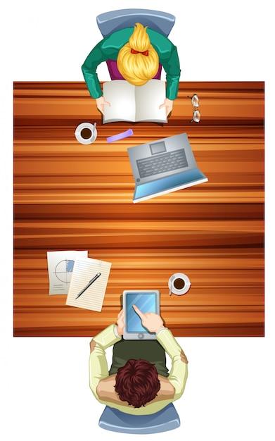 Personas en la vista superior del espacio de trabajo. Vector Premium