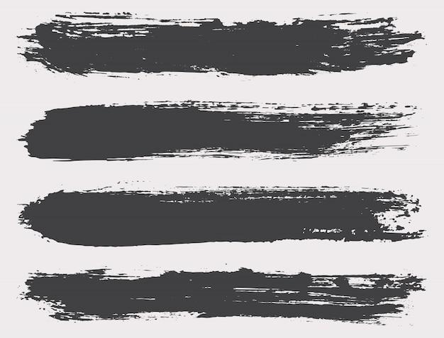 Pinceles grunge negro Vector Premium