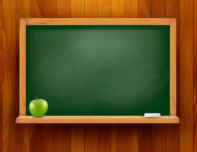 Pizarra con manzana verde sobre fondo de madera. Vector Premium
