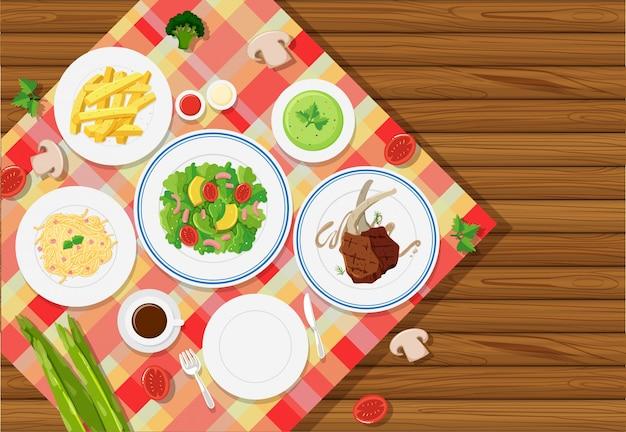 Plantilla de fondo con comida en mantel Vector Premium