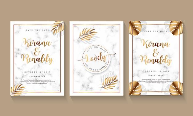 Plantilla de invitación de boda con diseño de mármol y elemento botánico. Vector Premium