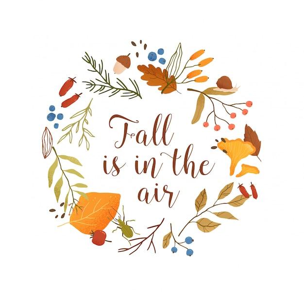 Plantilla plana de marco de círculo botánico de temporada de otoño. borde redondo de hojas y ramas con composición tipográfica. el otoño está en las letras del aire. ilustración de follaje, bayas del bosque y setas Vector Premium