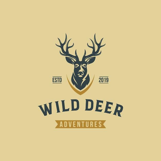 Plantilla de vector de diseño de logotipo vintage de ciervos salvajes Vector Premium