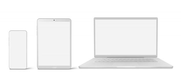 Portátil blanco, tableta y teléfono con pantalla en blanco vector gratuito