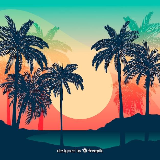 Puesta de sol en la playa con silueta de palmeras vector gratuito