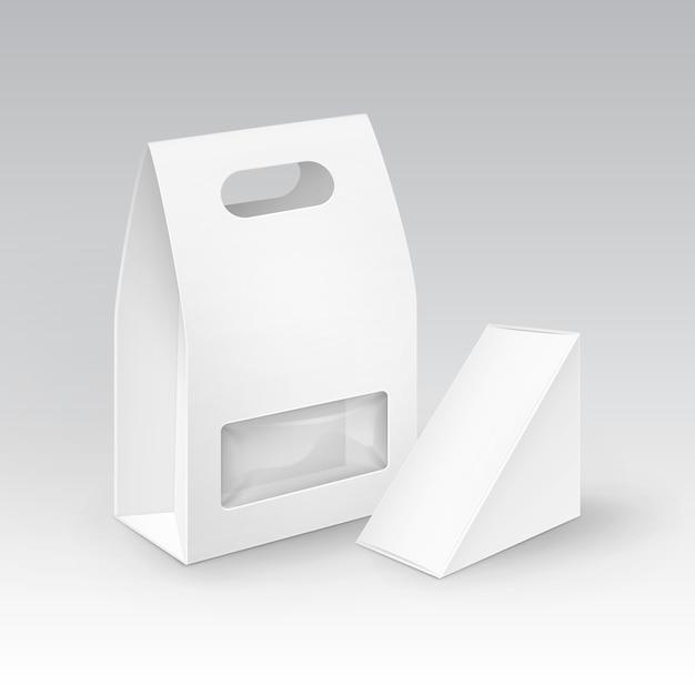 Rectángulo de cartón en blanco blanco triángulo para llevar asa cajas de almuerzo embalaje para sándwich, comida, regalo, otros productos con ventana de plástico mock up close up isolated Vector Premium