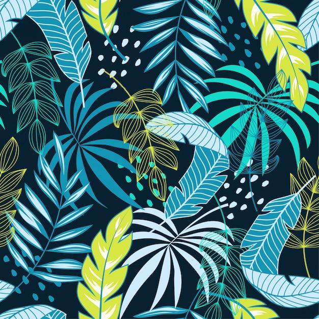 Resumen de patrones sin fisuras tropical con plantas y flores azules y verdes Vector Premium