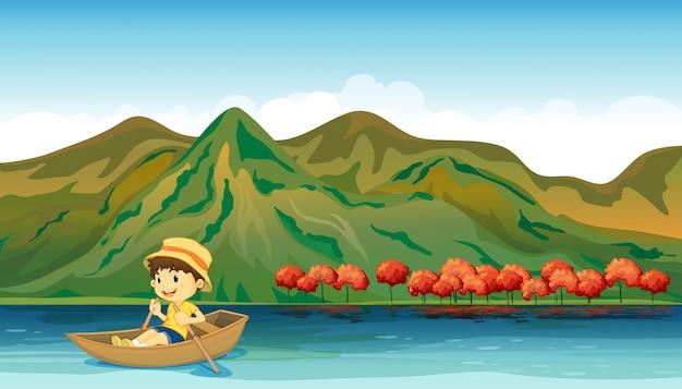 Un río y un niño sonriente en un bote. vector gratuito