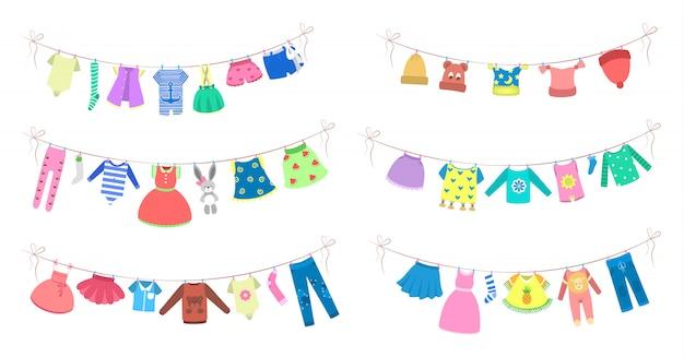 Ropa linda del bebé que se seca en la cuerda. ropa en la línea que se lava. vestido y vestuario, bragas y shorts. ilustración Vector Premium
