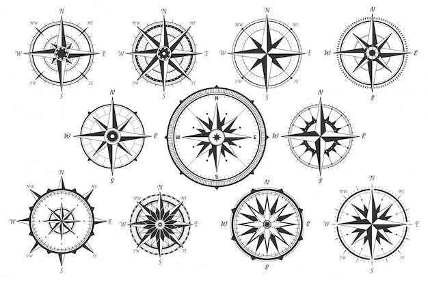 Rosa de los vientos. mapa de direcciones vintage brújula. iconos de medida de viento marino antiguo aislados Vector Premium