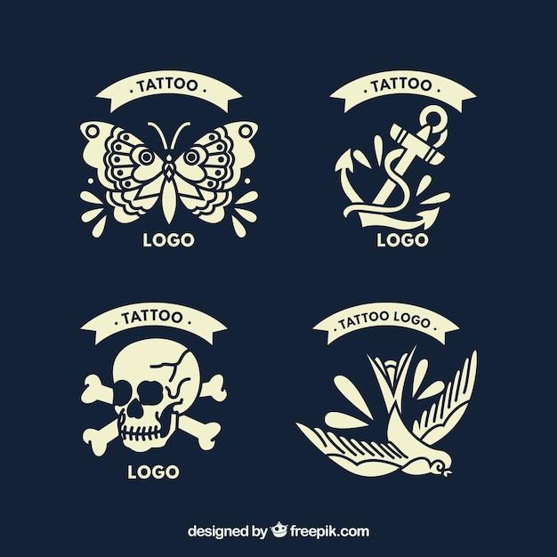 Set de cuatro logotipos de estudios de tatuaje en estilo vintage vector gratuito