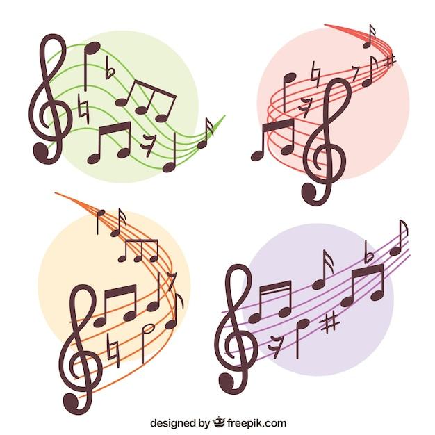 Set de pentagramas y notas musicales Vector Premium