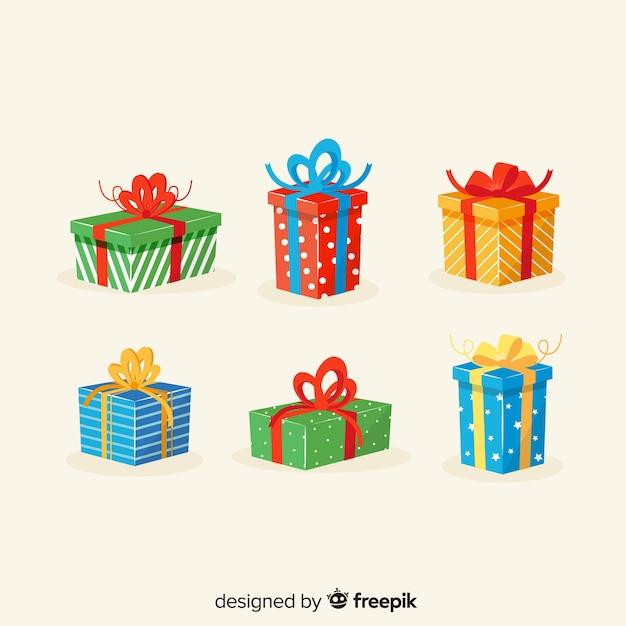 Set de regalo de navidad en diseño plano vector gratuito