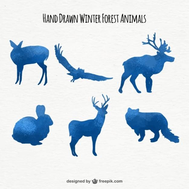 Set de siluetas de animales de acuarela de color azul vector gratuito