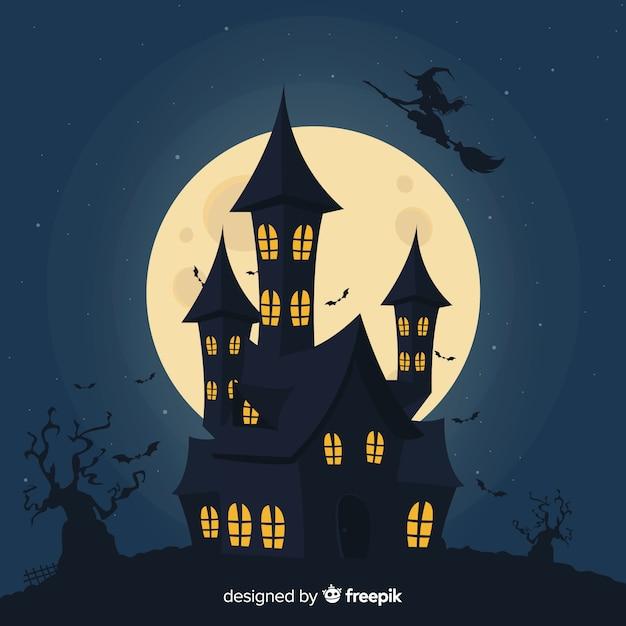 Silueta de una casa en una noche de luna llena vector gratuito