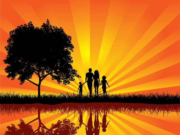 Silueta De Una Familia Caminando Al Atardecer