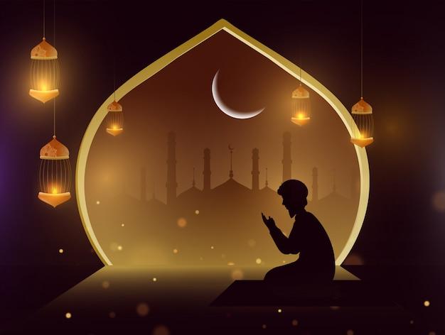 Silueta de un hombre haciendo oración (namaz) frente a la mezquita. Vector Premium