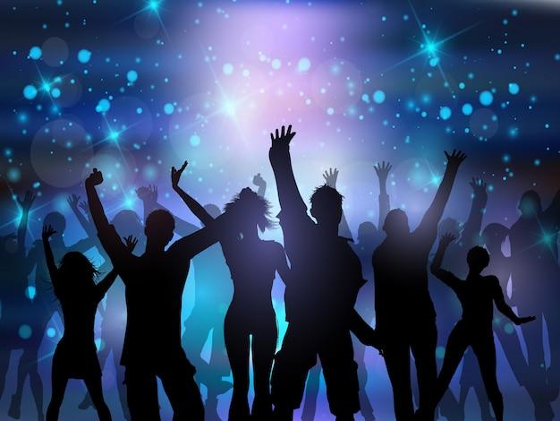 Siluetas De Personas Bailando Sobre Un Fondo De Luces