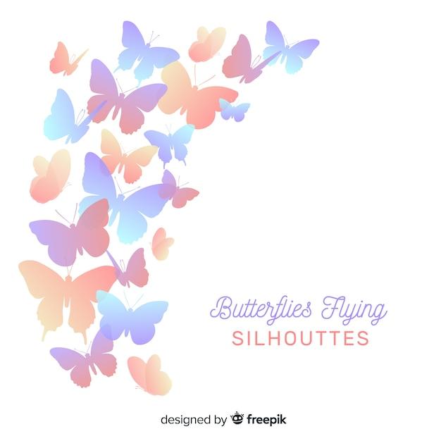 Siluetas de mariposas volando vector gratuito