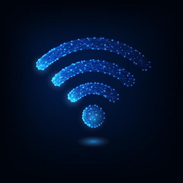 Símbolo poligonal bajo del wifi que brilla intensamente futurista aislado en azul marino. Vector Premium