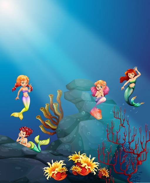 Sirenas nadando bajo el mar vector gratuito