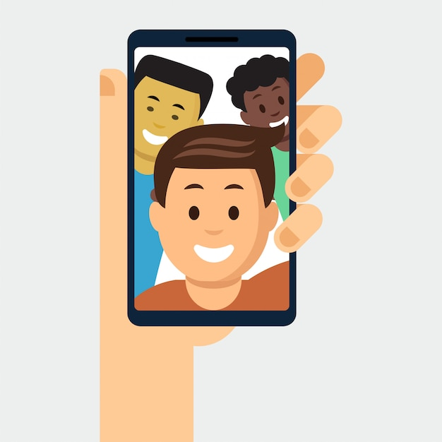 Smartphone con foto de amigos en exhibición Vector Premium