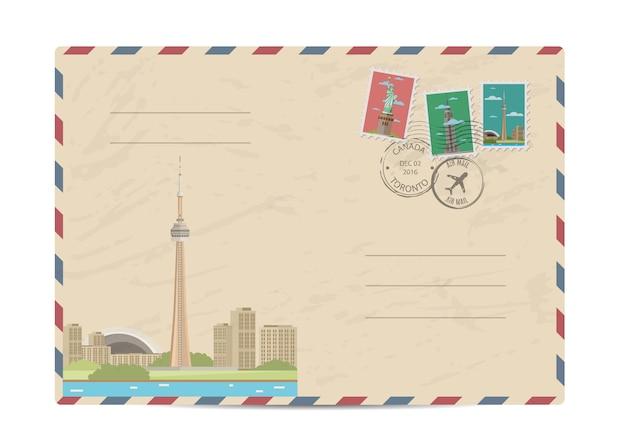 Sobre postal vintage con sellos Vector Premium