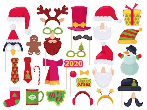 Stand de navidad. vacaciones personajes divertidos disfraces y sombreros para sesión de fotos fiesta enmascarado santa muñeco de nieve elfo vector Vector Premium