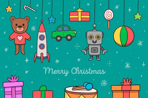 Surtido de juguetes navideños dibujados a mano vector gratuito