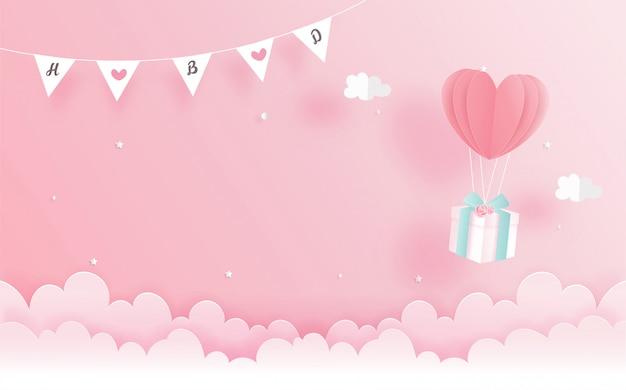 Tarjeta de cumpleaños con caja de regalo y globo de corazón en papel cortado estilo. ilustración vectorial Vector Premium