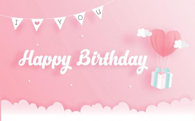 Tarjeta de cumpleaños con caja de regalo en papel cortado estilo. ilustración vectorial Vector Premium